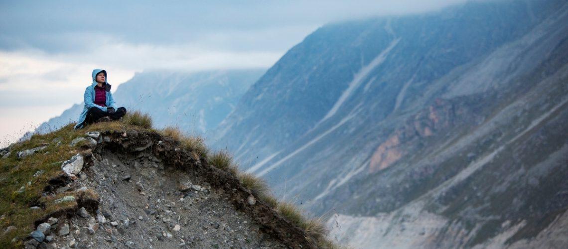 Woman thinking on mountain top